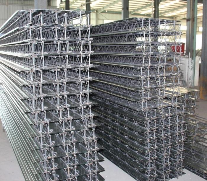 Steel sheet reinforced truss floor slab forming machine