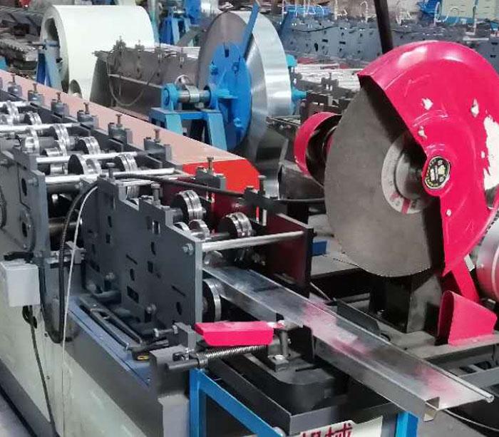 Rolling shutter door slat forming machine