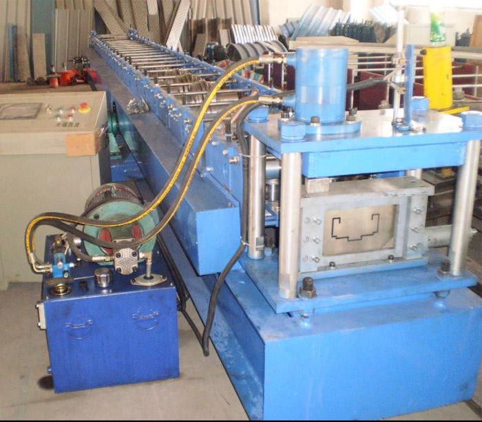 Steel door frame making machine